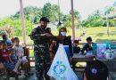 Satgas Yonif 144/Jy, Sosialisasikan Prokes Dan Posyandu di Perbatasan